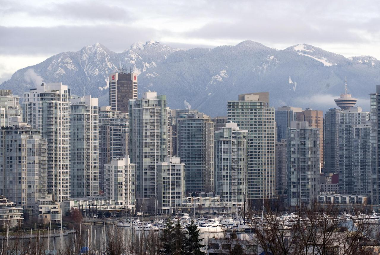 This file photo shows Vancouver skyline, pictured in 2009. Canada is monitoring an unmanned Japanese ship which was swept into the ocean during last year's tsunami, and will not allow it to wash ashore on the Canadian West Coast, according to the government. (AFP Photo/Don Emmert)