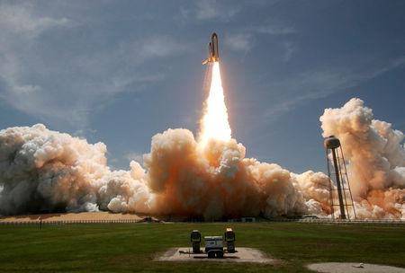 File Photo: The space shuttle Atlantis lifts off from launch pad 39A at the Kennedy Space Center in Cape Canaveral, Florida May 14, 2010. REUTERS/Pierre Ducharme/File Photo
