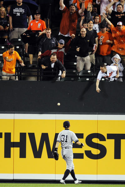 New York Yankees center fielder Ichiro Suzuki (31), of Japan, watches the ball bounce for a home run by Baltimore Orioles' Lew Ford (51) during the second inning of a baseball game, Saturday, Sept. 8, 2012, in Baltimore. (AP Photo/Nick Wass)