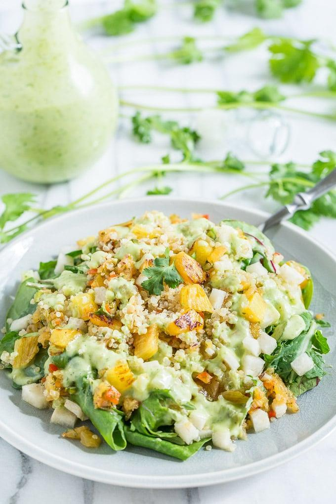 """<p>Take your taste buds to the tropics when you whip up this delightful salad. It has a lovely coconut-lime dressing that will make you forget about every other kind. Since this recipe was made to feed four to six, just cut it in half and you'll have enough for two people.</p> <p><strong>Get the recipe:</strong> <a href=""""http://getinspiredeveryday.com/food/tropical-quinoa-salad-with-coconut-lime-dressing"""" class=""""link rapid-noclick-resp"""" rel=""""nofollow noopener"""" target=""""_blank"""" data-ylk=""""slk:tropical quinoa salad with jicama and coconut-lime dressing"""">tropical quinoa salad with jicama and coconut-lime dressing</a></p>"""