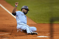 Toronto Blue Jays' Teoscar Hernandez slides into home plate to score on a single by Cavan Biggio during the first inning of the team's baseball game against the Boston Red Sox at Fenway Park, Thursday, July 29, 2021, in Boston. (AP Photo/Elise Amendola)