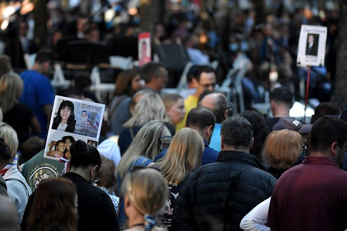 NEW YORK, NEW YORK - SEPTEMBER 11: The photo of a 9/11 victim is carried by family and friends as they attend a ceremony commemorating  the 20th anniversary of the 9/11 attacks on the World Trade Center on September 11, 2021 in New York City. The nation is marking the 20th anniversary of the terror attacks of September 11, 2001, when the terrorist group al-Qaeda flew hijacked airplanes into the World Trade Center, Shanksville, PA and the Pentagon, killing nearly 3,000 people. (Photo by Ed Jones-Pool/Getty Images)