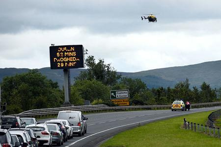FILE PHOTO: A sign for customs and excise is seen on the motorway approaching the border between Northern Ireland and Ireland, near Newry