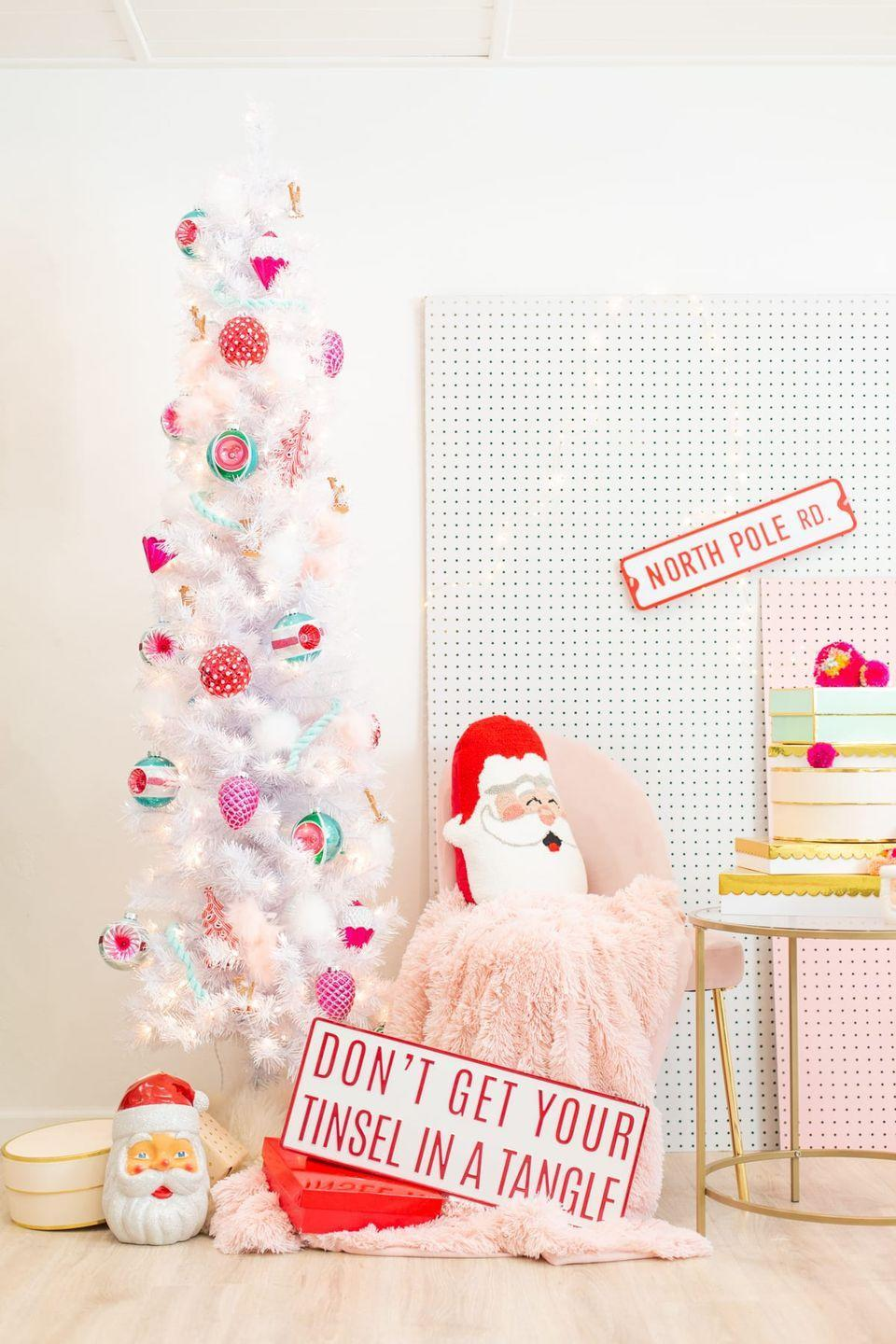 """<p>Keep things modern and interesting with a fun pink, red, and green color palette.</p><p><strong><em>Get the tutorial at <a href=""""https://lovelyindeed.com/hey-holidays-a-pink-red-and-green-christmas-tree/"""" rel=""""nofollow noopener"""" target=""""_blank"""" data-ylk=""""slk:Lovely Indeed"""" class=""""link rapid-noclick-resp"""">Lovely Indeed</a>. </em></strong></p><p><a class=""""link rapid-noclick-resp"""" href=""""https://www.amazon.com/dp/B017E9ZHMU/?tag=syn-yahoo-20&ascsubtag=%5Bartid%7C10070.g.2025%5Bsrc%7Cyahoo-us"""" rel=""""nofollow noopener"""" target=""""_blank"""" data-ylk=""""slk:SHOP BLUE ROPE GARLAND"""">SHOP BLUE ROPE GARLAND</a></p>"""