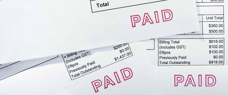 Three invoices for several thousand dollars, all with PAID stamp. These are normal bills, with folds and a few creases.