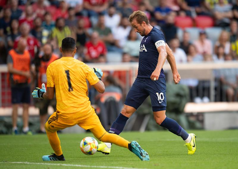 MUNICH, GERMANY - JULY 30: Harry Kane of Tottenham (R) scores his team's first goal against Keylor Navas of Real Madrid during the Audi cup 2019 semi final match between Real Madrid and Tottenham Hotspur at Allianz Arena on July 30, 2019 in Munich, Germany. (Photo by Tottenham Hotspur FC via Getty Images/Tottenham Hotspur FC via Getty Images via Getty Images)