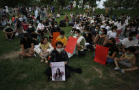 Women's rights activists attend a candle light vigil to pay tribute to Noor Mukadam, who was recently beheaded, and other domestic violence victims in Islamabad, Pakistan, Sunday, July 25, 2021. The killing of Kukadam in an upscale neighborhood of Pakistan's capital has shone a spotlight on the relentless violence against women in the country. Rights activists say such gender-based assaults are on the rise as Pakistan barrels toward greater religious extremism. (AP Photo/Anjum Naveed)