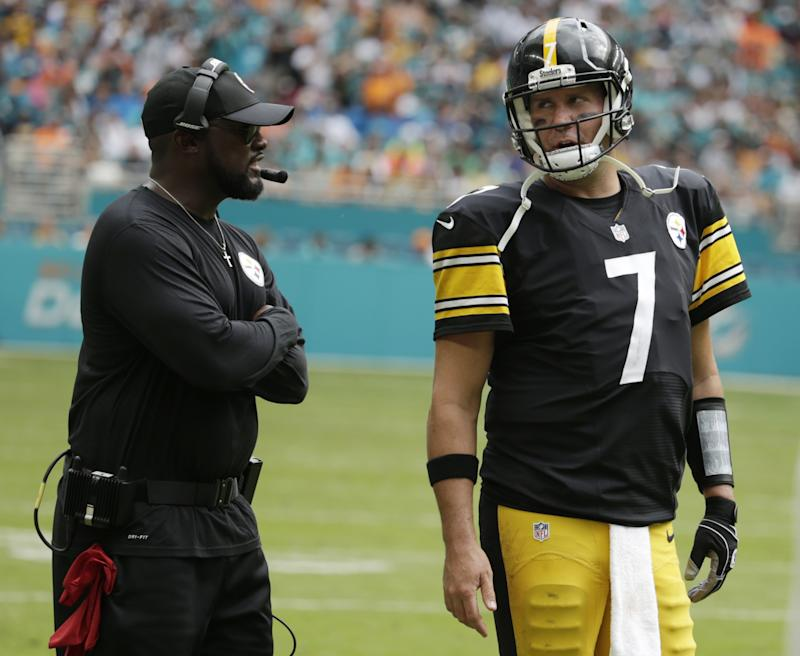 Mike Tomlin, left, and Ben Roethlisberger discuss what went wrong for the Pittsburgh Steelers against the Miami Dolphins. (AP)