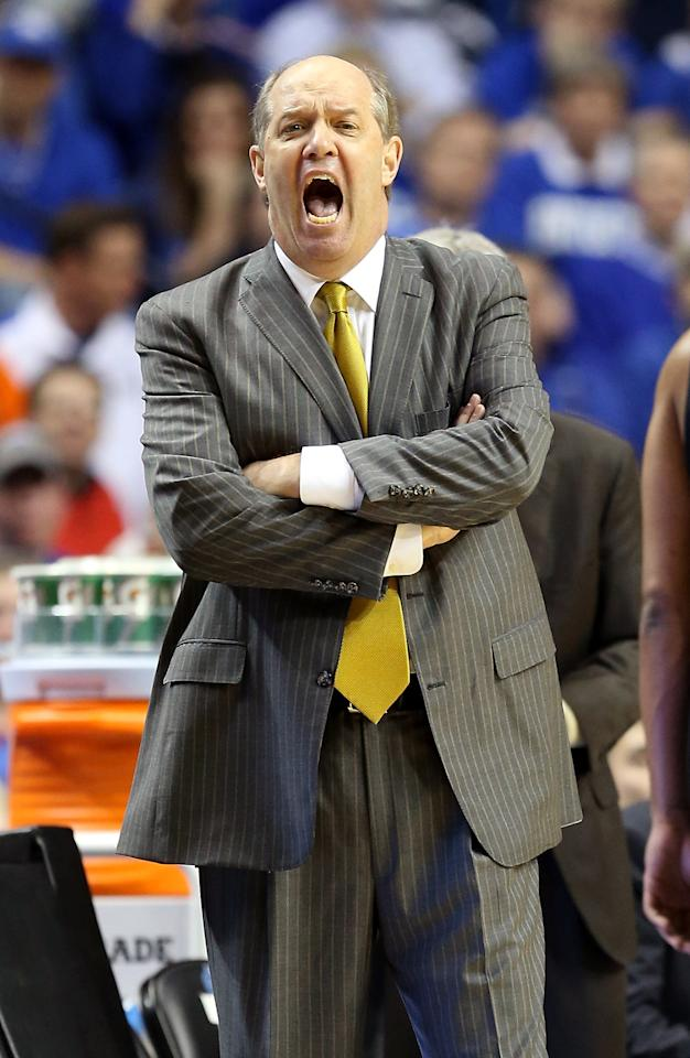 Head coach Kevin Stallings of the Vanderbilt Commodores yells from the sideline during the second half against the Kentucky Wildcats during the Quarterfinals of the SEC basketball tournament at Bridgestone Arena on March 15, 2013 in Nashville, Tennessee.  (Photo by Andy Lyons/Getty Images)