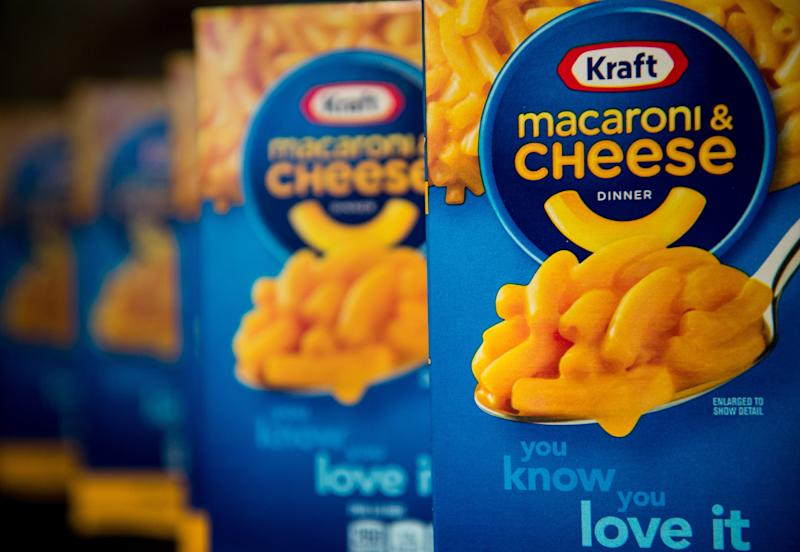 WITH AFP STORY: LIFESTYLE-US-FOOD-KRAFT-MACANDCHEESE This photo illustration shows packs of Kraft's macaroni and cheese in Washington on April 21, 2015. From January next year, two kinds of yellow dye will no longer be added to the packaged dry pasta and processed cheese mix that is famous for its gooey yellow-orange look. Instead, natural ingredients like paprika, annatto and turmeric will be used, said Kraft in a statement on April 20th that promised no change in how Mac and Cheese actually tastes. AFP PHOTO / NICHOLAS KAMM (Photo credit should read NICHOLAS KAMM/AFP via Getty Images)