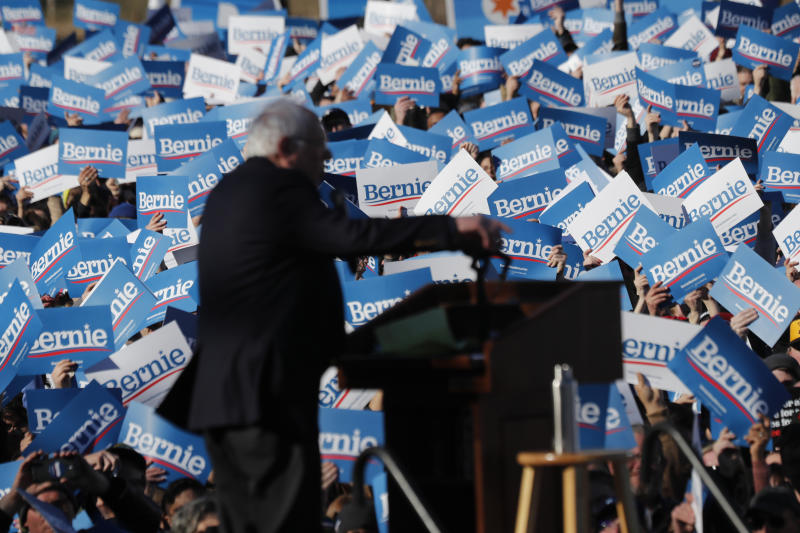 Supporters of Democratic presidential candidate Sen. Bernie Sanders, I-Vt., wave their campaign signs at a rally in Chicago's Grant Park Saturday, March 7, 2020. (AP Photo/Charles Rex Arbogast)