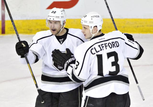 Los Angeles Kings Trevor Lewis (22) and Kyle Clifford (13) celebrate a goal against the Edmonton Oilers during second period NHL hockey action in Edmonton, Alberta, on Sunday March 9, 2014. (AP Photo/The Canadian Press, Jason Franson)