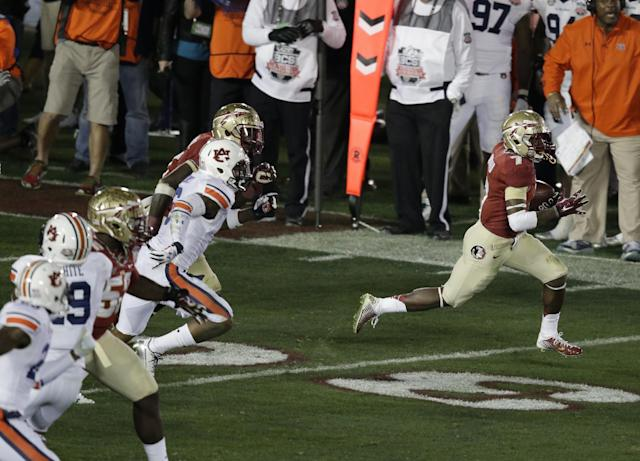 Florida State's Levonte Whitfield runs back a kick off 100 yards for a touchdown during the second half of the NCAA BCS National Championship college football game against Auburn Monday, Jan. 6, 2014, in Pasadena, Calif. (AP Photo/Gregory Bull)