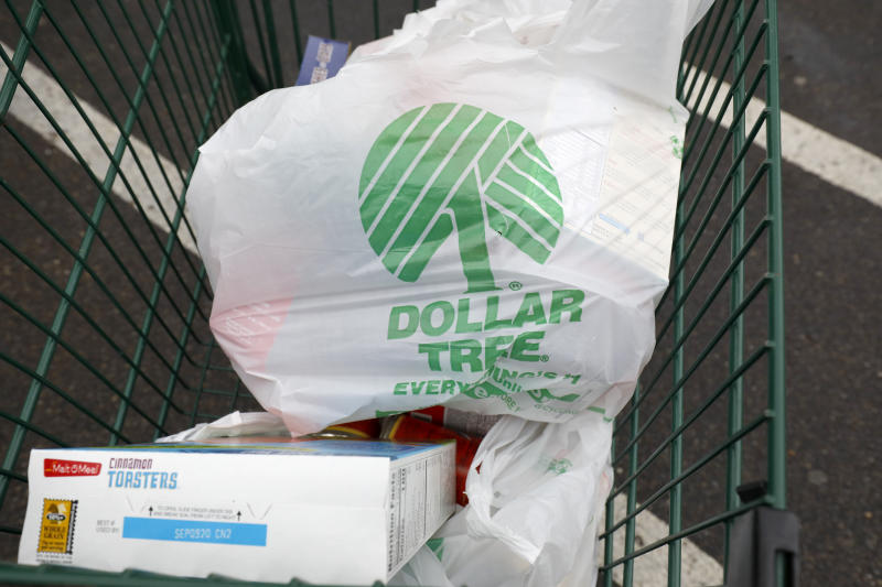 Shopping bags rest in a shopping cart from a Richland, Miss., Dollar Tree store on Tuesday, Nov. 26, 2019. (AP Photo/Rogelio V. Solis)