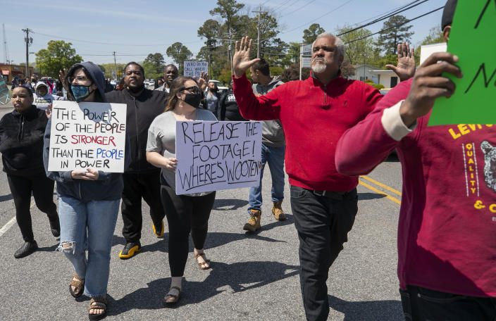 Kirk Rivers leads a group of demonstrators as they block Ehringhaus Street, a main retail avenue in Elizabeth City, N.C., Friday, April 23, 2021, as they demand after a fatal shooting that body camera video be released by the Pasquotank Sheriff's office. Andrew Brown Jr., a 42-year-old Black man from Elizabeth City, N.C., was shot to death Wednesday by one or more deputy sheriffs trying to serve drug-related search and arrest warrants. (Robert Willett/The News & Observer via AP)