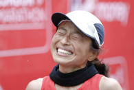 FILE - In this April 28, 2019, file photo, Japan's Misato Michishita celebrates after winning the woman's visually impaired race at the 39th London Marathon in London. The visually impaired Japanese office worker landed an invitation to compete in Monday's Boston Marathon, where she will be featured in a new para-athlete division being unveiled for the 125th edition of the race. (AP Photo/Alastair Grant, File)