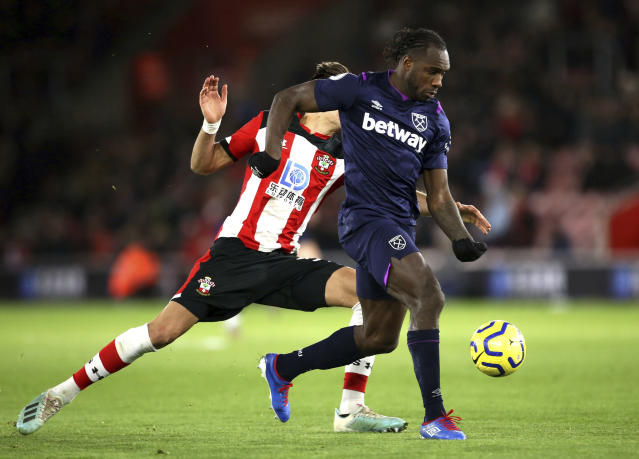 West Ham United's Michail Antonio, right, ahead of scoring his second goal against Southampton, which was later disallowed, during their English Premier League soccer match at St Mary's Stadium in Southampton, England, Saturday Dec. 14, 2019. (Steven Paston/PA via AP)