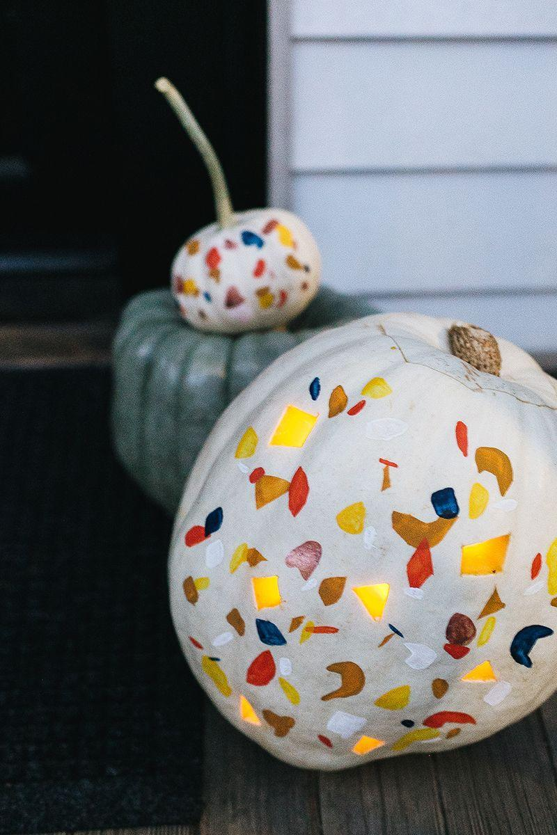 "<p>Rather than crafting ghoulish Halloween gourds, turn your pumpkin patch picks into works of art. If you're paintbrush-savvy, you can easily freehand the colorful geometric designs. Otherwise, use stencil paper to outline your own shapes. Finish it off with matching cutouts to let candlelight peek through.</p><p><strong>Get the tutorial at <a href=""https://jojotastic.com/2018/10/08/terrazzo-pumpkin-diy/"" rel=""nofollow noopener"" target=""_blank"" data-ylk=""slk:Jojotastic"" class=""link rapid-noclick-resp"">Jojotastic</a>. </strong></p><p><strong><a class=""link rapid-noclick-resp"" href=""https://www.amazon.com/JINSEY-Make-Your-Own-Stencil/dp/B0787WVXDM/?tag=syn-yahoo-20&ascsubtag=%5Bartid%7C10050.g.279%5Bsrc%7Cyahoo-us"" rel=""nofollow noopener"" target=""_blank"" data-ylk=""slk:SHOP STENCIL PAPER"">SHOP STENCIL PAPER</a><br></strong></p>"