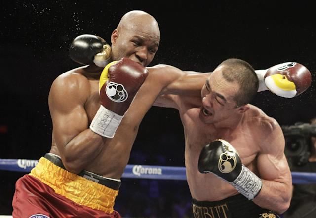 Bernard Hopkins, of the United States, and Beibut Shumenov, of Kazakhstan, fight during their IBF, WBA and IBA Light Heavyweight World Championship unification boxing match, Saturday, April 19, 2014, in Washington. Hopkins won by a split decision. (AP Photo/Luis M. Alvarez)