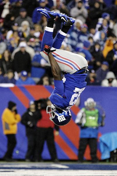 FILE - In this Dec. 9, 2012, file photo, New York Giants running back David Wilson (22) flips after scoring on a 6-yard touchdown run during the second half of an NFL football game against the New Orleans Saints in East Rutherford, N.J. Not once, not twice, but three times the rookie produced near-perfect backflips after scoring touchdowns in a 52-27 win over the Saints. (AP Photo/Kathy Willens, File)