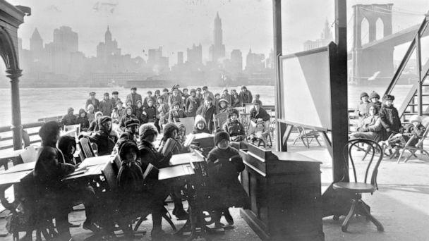 PHOTO: An open air class on a ferryboat with Manhattan and the Brooklyn Bridge in the background, 1911. (Bureau of Charities, Brooklyn, via Library of Congress)