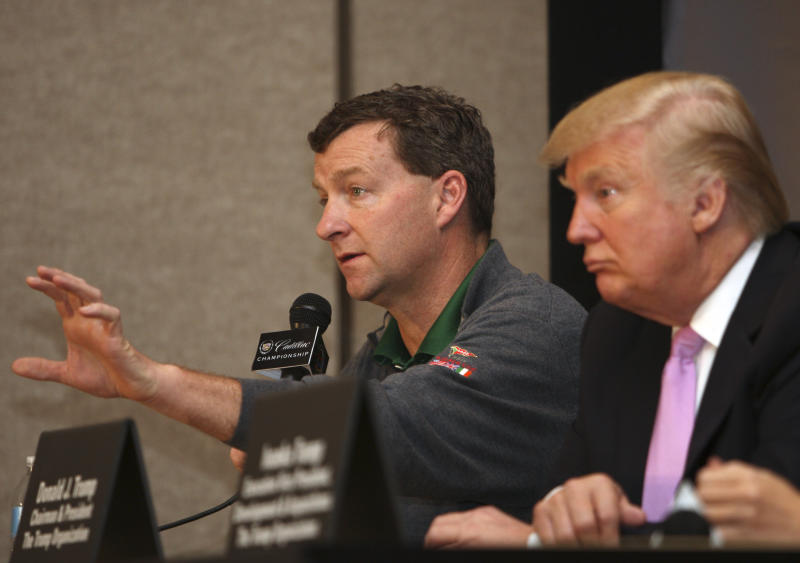 Golf course designer Gil Hanse, left, speaks during a news conference at the Cadillac Championship golf tournament, as Donald Trump, right, looks on, Thursday, March 8, 2012, in Doral, Fla. Trump purchased the Doral Hotel & Country Club, which includes four championship golf courses. (AP Photo/Lynne Sladky)