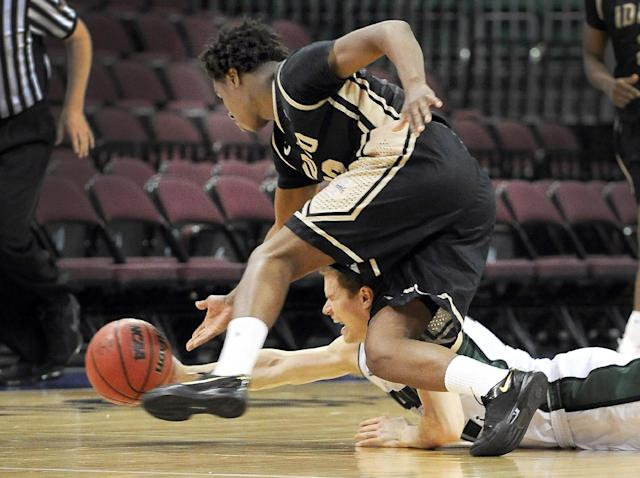 Idaho's Mike Scott, left, and Utah Valley's Holton Hunsaker chase a loose ball during the second half of an NCAA college men's basketball game in the semifinals of the West Athletic Conference tournament Friday, March 14, 2014, in Las Vegas. Idaho won 74-69. (AP Photo/David Becker)