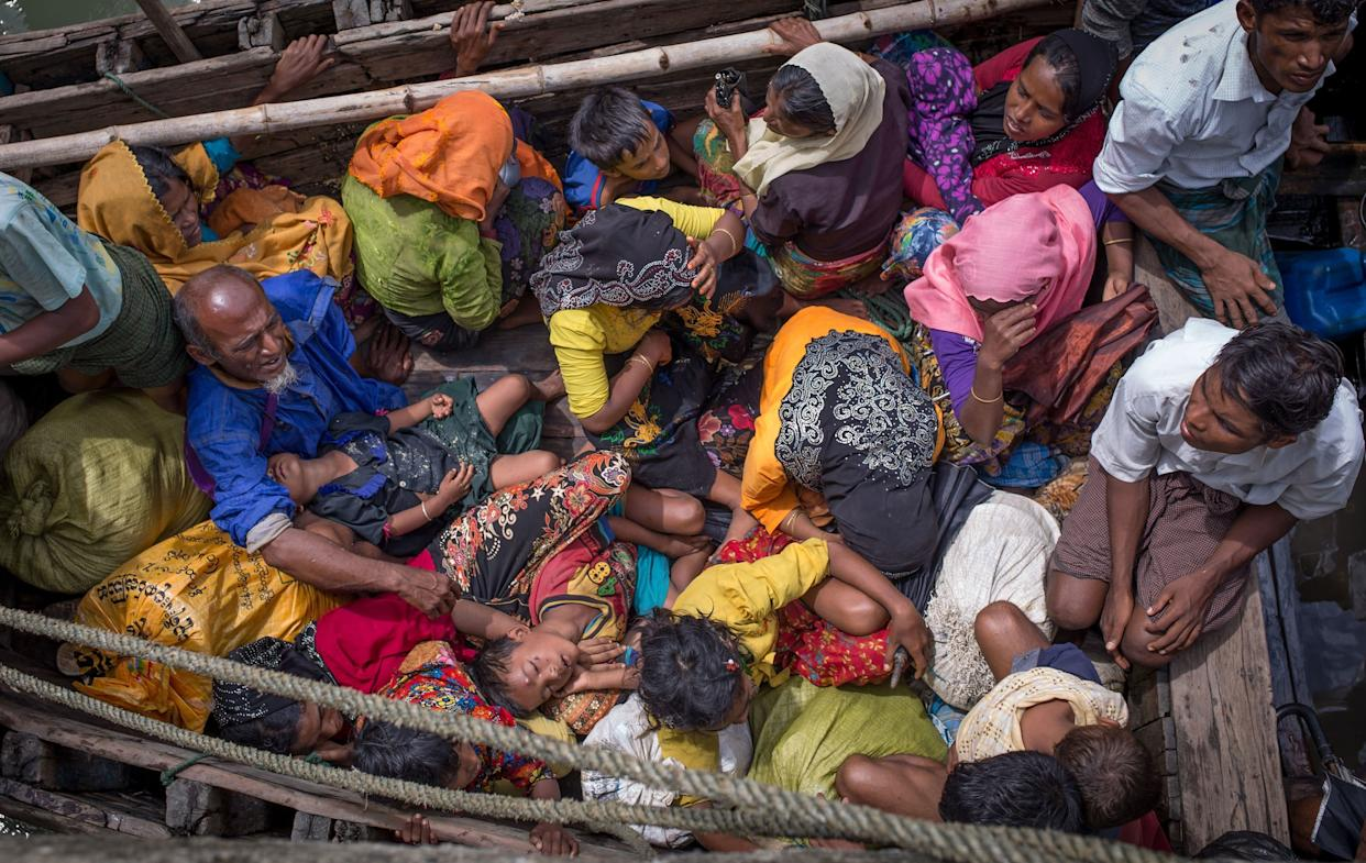 This photograph taken on Sept. 12, 2017, shows Rohingya refugees arriving by boat at Shah Parir Dwip on the Bangladesh side of the Naf River after fleeing violence in Myanmar.