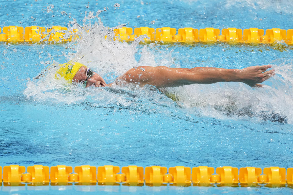 Emma McKeon, of Australia, swims in a heat of the women's 100-meter freestyle at the 2020 Summer Olympics, Wednesday, July 28, 2021, in Tokyo, Japan. (AP Photo/Petr David Josek)