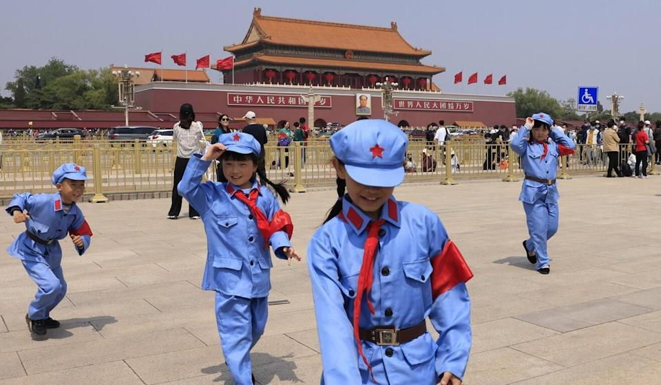 Children dressed as revolutionary soldiers outside the Forbidden City in Beijing. Photo: AP