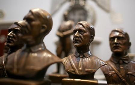 Busts of Hitler are displayed during a news conference at the Holocaust museum in Buenos Aires