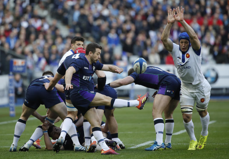 Scotland's Greig Laidlaw clears the ball following a scrum during the Six Nations rugby union international match between France and Scotland at the Stade de France in Paris, Saturday, Feb. 23, 2019. (AP Photo/Christophe Ena)