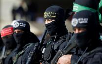Members of Palestinian militant groups take part in their first-ever joint exercise, in Gaza City