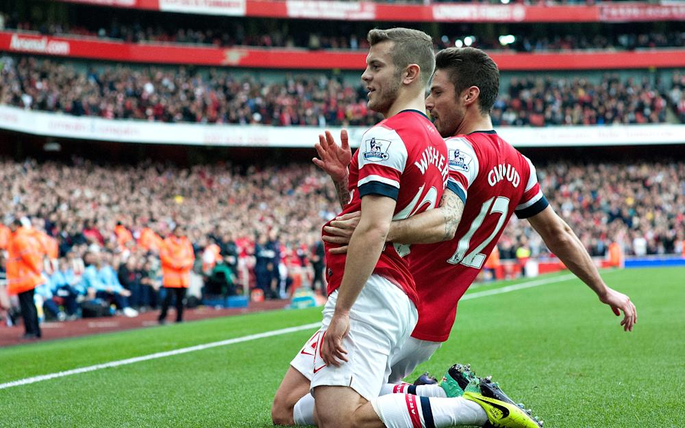 jack wilshere celebrates scoring vs norwich - Credit: AP