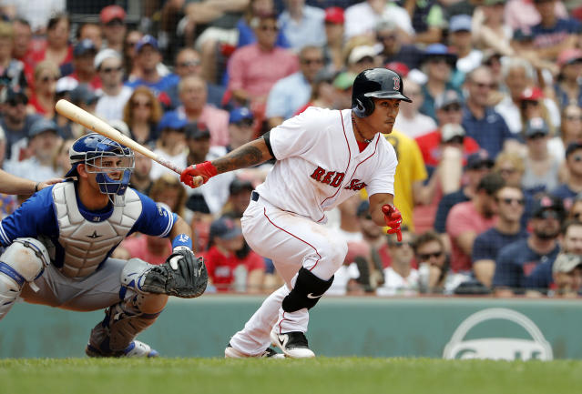 Boston Red Sox's Tzu-Wei Lin follows through on his single against the Toronto Blue Jays during the fifth inning of a baseball game Saturday, July 14, 2018, in Boston. (AP Photo/Winslow Townson)