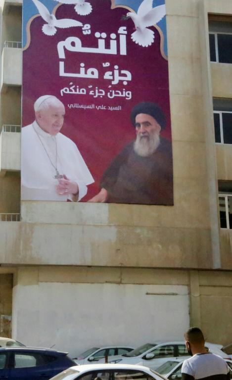 A billboard shows Francis and the Grand Ayatollah Ali Sistani, the highly reclusive cleric who is the top religious authority for many of the world's Shiite Muslims