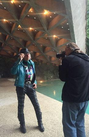 Owner James Goldstein poses for a photo at his residence, which was designed by modernist architect John Lautner, during a media event in Los Angeles, California February 17, 2016. REUTERS/Piya Sinha-Roy