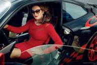 <p>Jenner looked fierce in a red Donna Karan dress and tortoise cat's-eye sunglasses. The $180,000 2011 Porsche 911 GT3 RS that she's sitting in was a gift from Kris Jenner.</p>