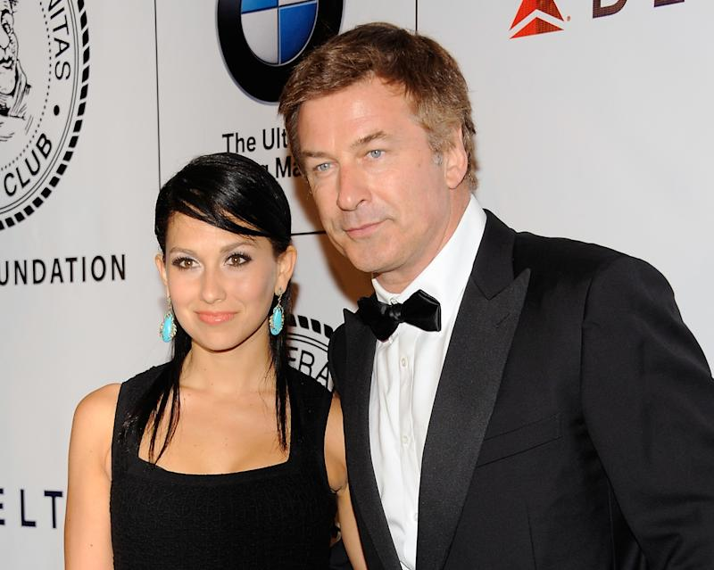"FILE - This June 12, 2012 file photo shows actor Alec Baldwin and his fiancee Hilaria Thomas at The Friars Club and Friars Foundation Honor of Tom Cruise at The Waldorf-Astoria in New York. A New York City news photographer says he was punched by Alec Baldwin outside a marriage license bureau in Manhattan. The Daily News reports that Marcus Santos was snapping images of the ""30 Rock"" star with his fiancée Hilaria Thomas Tuesday, June 19. Santos told the paper that Baldwin grabbed a second news photographer, then started shoving Santos and hit him in the chin. He then walked away. Photos on the newspaper's website appear to show Baldwin shoving the photographer. No police report has been filed. A call to the newspaper's public relations office wasn't returned.  (Photo by Evan Agostini/Invision/AP, file)"