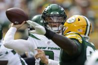 New York Jets' Zach Wilson throws during the first half of a preseason NFL football game against the Green Bay Packers Saturday, Aug. 21, 2021, in Green Bay, Wis. (AP Photo/Matt Ludtke)