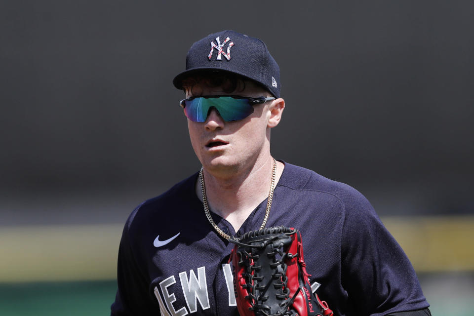 FILE - In this March 9, 2020, file photo, New York Yankees' Clint Frazier runs to the dugout during a spring training baseball game in Clearwater, Fla. Brett Gardner's return to the Yankees won't displace Clint Frazier from taking over as New York's starting left fielder. Manager Aaron Boone said Saturday, Feb. 20, 2021, that the 26-year-old Frazier remained his first choice in left while cautioning developments during a season could alter intentions. (AP Photo/Carlos Osorio, File)