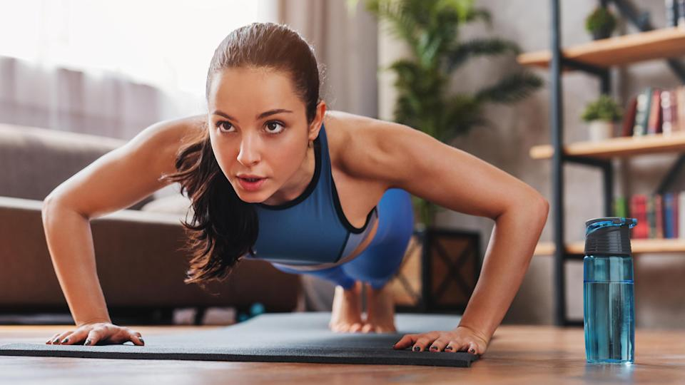 Woman doing a Tabata workout, a form of HIIT
