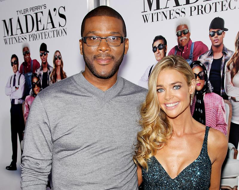 """This June 25, 2012 photo released by Starpix shows actors Tyler Perry, left, and Denise Richards, at the premiere of  the Lionsgate film, """"Tyler Perry's: Madea's Witness Protection,"""" at the AMC Lincoln Square Theater in New York.  The film, starring Perry, Richards, Romeo, and Eugene Levy, opens nationwide on June 29. (AP Photo/Starpix, Marion Curtis)"""