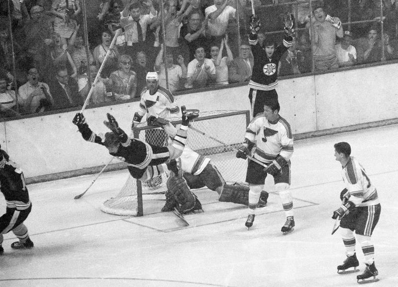 FILE - In this May 10, 1970, file photo, Boston Bruins' Bobby Orr flies through the air after scoring the winning goal past St. Louis Blues' goalie Glenn Hall during overtime in the NHL hockey Stanley Cup finals in Boston. (AP Photo/A.E. Maloof, File)
