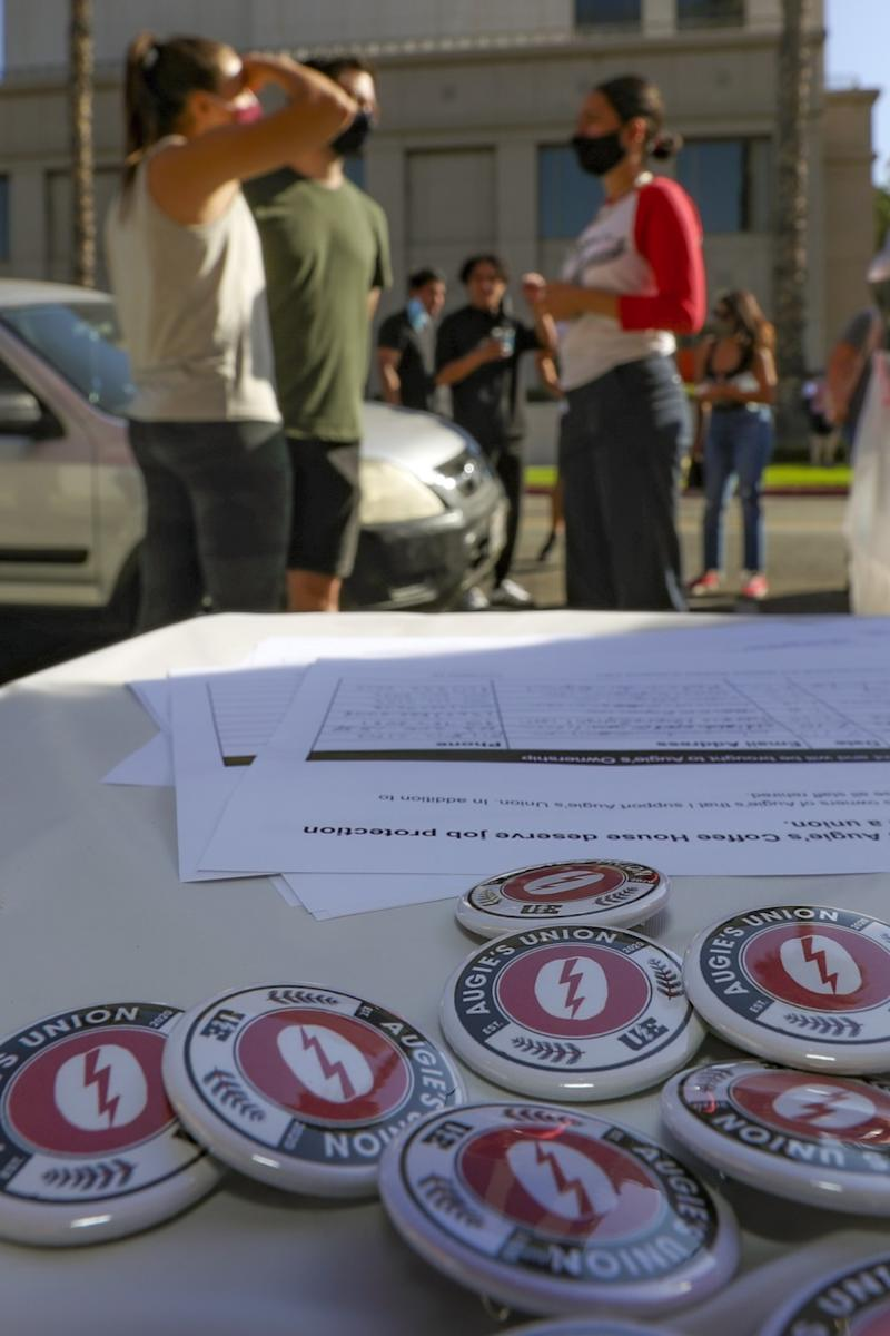 Workers organized a petition drive demanding that Augie's Coffee House to reopen.