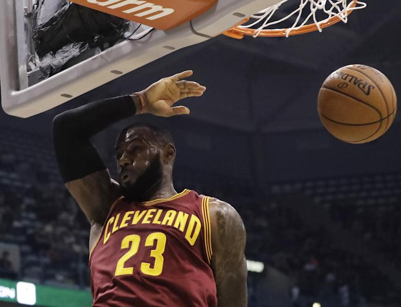 Cleveland Cavaliers' LeBron James dunks during the first half of an NBA basketball game against the Milwaukee Bucks Tuesday, Nov. 29, 2016, in Milwaukee. (AP Photo/Morry Gash)