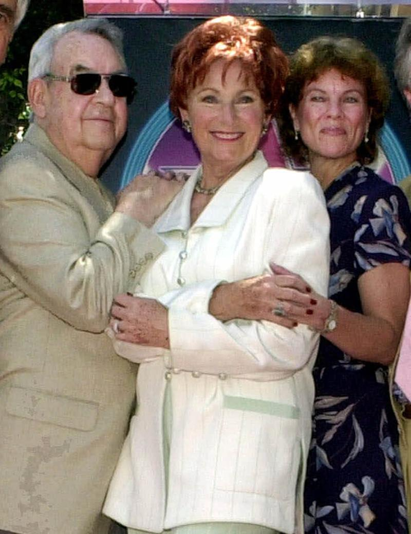 "FILE - In this July 12, 2001 file photo, from left, actors Tom Bosley, Marion Ross, and Erin Moran, Williams, of the television show ""Happy Days,"" pose  after Ross received a star on the Hollywood Walk of Fame in the Hollywood section of Los Angeles. A Los Angeles judge on Tuesday, June 5, 2012 denied a motion by CBS Studios and Paramount Pictures to dismiss claims by several former ""Happy Days"" cast members that they are owed royalties on DVD sales of the hit comedy series. A trial is scheduled for July.  The lawsuit was brought by cast members including Ross, Moran and Patricia Bosley, wife of Tom Bosley, who died of heart failure on Oct. 19, 2010. (AP Photo/E.J. Flynn, file)"