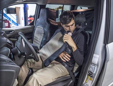 "The Ford and Virginia Tech research simulated a self-driving vehicle using a ""seat suit"" to conceal the human driver. This was done to explore pedestrian reaction to external lighting signals that indicate when the vehicle is driving, yielding or accelerating from a stop in Arlington, Virginia, in this handout photo obtained by Reuters September 13, 2017.   Ford Motor Company/Handout via Reuters"