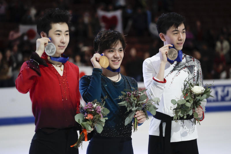 From left; silver medal winner Boyang Jin, of China, gold medal winner, Shoma Uno, of Japan, and bronze medal winner, Vincent Zhou, of the United States, pose at the Four Continents Figure Skating Championships on Saturday, Feb. 9, 2019, in Anaheim, Calif. (AP Photo/Chris Carlson)