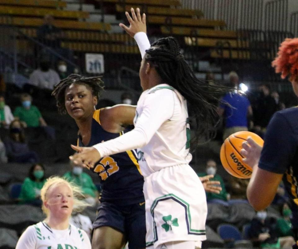 Keenan's MiLaysia Fulwiley (23) passes behind her back to Keenan's Tamyra Davis (13) during the 3A state championship game at the USC Aiken Convocation Center on Friday, March 5, 2021.